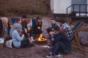 image of people sitting around a campfire